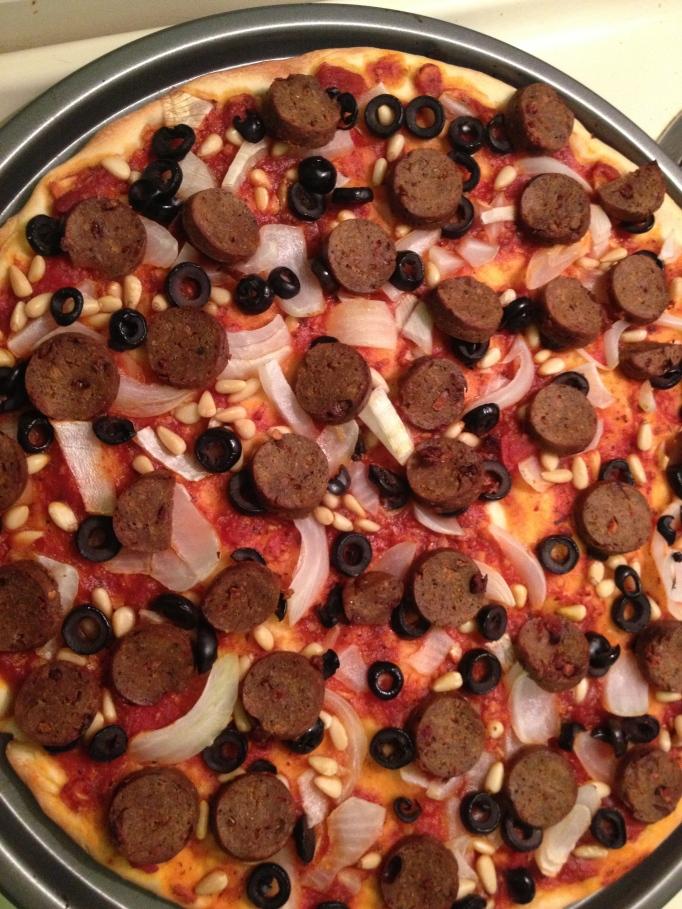 pine nut and vegan sausage pizza